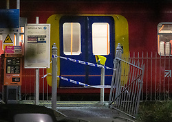 © Licensed to London News Pictures. 04/01/2019. Horsley, UK. A train remains cordoned off at Horsley Railway station in Surrey where a man has been stabbed to death. A murder investigation has been launched after the man was attacked while on board the 12. 58pm train service travelling between Guildford and London Waterloo. . Photo credit: Peter Macdiarmid/LNP