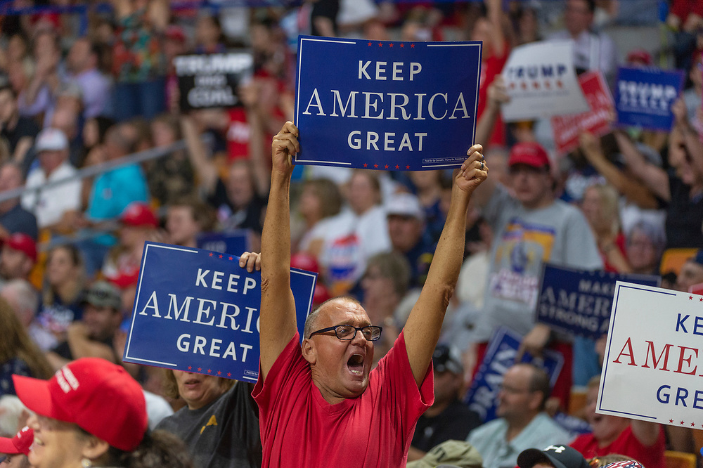A supporter holds a sign aloft before President Trump takes the stage at a rally in support of the Senate candidacy of Attorney General Patrick Morrisey, Monday, Aug. 21, 2018, at the Charleston Civic Center in Charleston, W.Va.