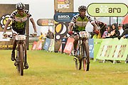 Azukile Simayile and Sipho Madolo of Team Meerendal Songo Specialized maintain their lead after winning the Exarro category of stage 1 of the 2014 Absa Cape Epic Mountain Bike stage race held from Arabella Wines in Robertson, South Africa on the 24 March 2014<br /> <br /> Photo by Greg Beadle/Cape Epic/SPORTZPICS