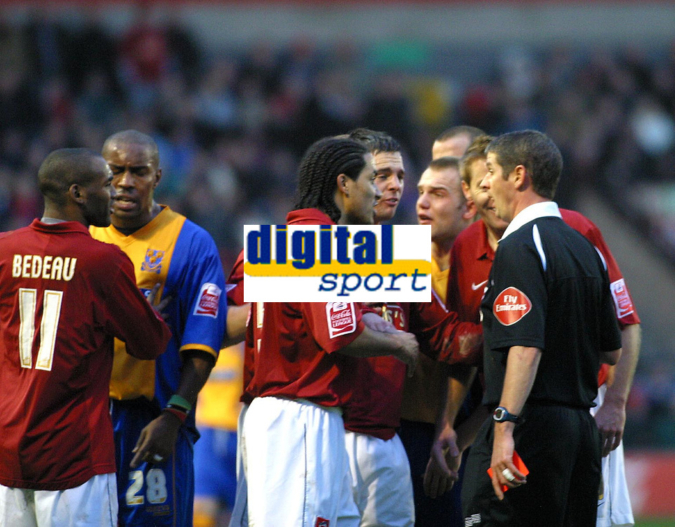Photo: Dave Linney.<br />Walsall v Shrewsbury Town. Coca Cola League 2. 26/12/2006.  Walsall Players surrond the referee after the sending off of Tommy Wright.