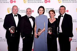 Colin Wratten, Harry Bradbeer, Phoebe Waller-Bridge, Kim Bodnia and Sally Woodward Gentle in the press room with the award for Drama Series at the Virgin Media BAFTA TV awards, held at the Royal Festival Hall in London.