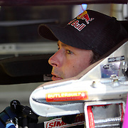 Rousch-Fenway Racing Ford driver Travis Pastrana sits in his car while parked in the garage area, during a NASCAR Drive4COPD Nationwide Series practice session at Daytona International Speedway on Thursday, February 21, 2013 in Daytona Beach, Florida.  (AP Photo/Alex Menendez)