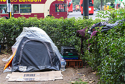 Clothes lie strewn over hedges on the central island of Park Lane at Marble arch whilst plastic sheeting covers a leaky tent in what appears to be a semi-permanent camp. Over the last few years London has seen increasing numbers of Eastern European beggars and street performers on its streets as they flock to the UK and other wealthier countries to take advantage of people's generosity. London, August 02 2019.