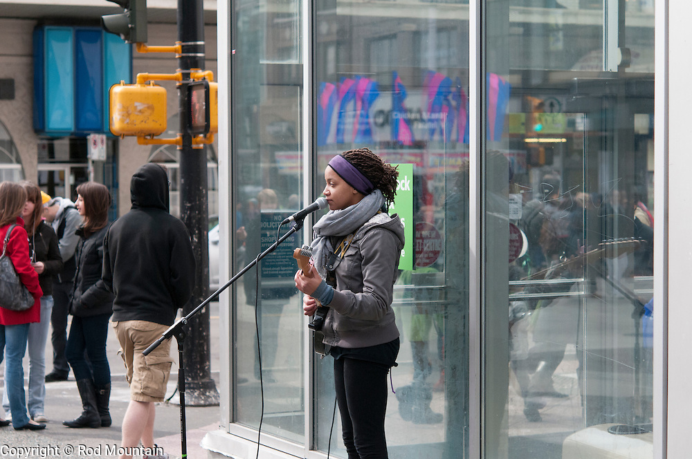 A solo performer sings and plays the guitar for St. Patrick's Day in Vancouver, British Columbia.