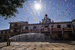 July 25, 2018 - Carpio Tajo, Toledo, Spain - A man seen watering the enclosure where the horses will run the festival..The St. James Festival in the village of El Carpio de Tajo near Toledo, Spain. The event involves horsemen galloping towards geese suspended by their feet as the mounted participant yanks on the bird's neck until it is torn off. (Credit Image: © Manu Reino/SOPA Images via ZUMA Wire)