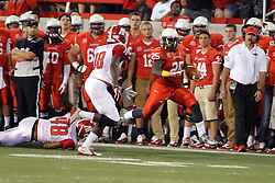27 September 2014:  Marshaun Coprich looks off Damien Whitfield after Zach Stuart falls away as he strides towards the goal line on a significant run during an NCAA football game between the Austin Peay Governors and the Illinois State Redbirds at Hancock Stadium in Normal IL