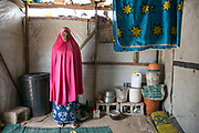 Falmata M, 13, stands in her room at an IDP camp in Maiduguri, Nigeria, April 20, 2019. Falmata was abducted in Banki District six months ago to Sambisa Forest and was forced to marry a Boko Haram commander as the fourth wife. After a few attempts to escape, she was stroked with a cane then raped. After that incident, she escaped the forest, but met with BH fighters on the road block. After getting beaten up again, she scuffled with the fighters, jumped on the trench and escaped to Banki. She came to the Maiduguri's camp 70 days ago.