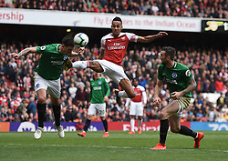 Brighton & Hove Albion's Lewis Dunk somehow gets his head on the ball to prevent Arsenal's Pierre-Emerick Aubameyang scoring a late winner