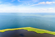 Nederland, Noord-Holland, Amsterdam, 13-06-2017; Barnegat en Uitdammerdijk, landelijk Noord. Zicht op IJsselmeer, Flevoland aan de horizon.<br /> De dijk staat op de nominatie om verstrekt te worden, bewoners en actievoerders vrezen aantasting van de monumentale dijk en verlies culturele waarden.<br /> Barnegat en Uitdammerdijk, rural area, North of Amsterdam.<br /> The dike is nominated to be reinforced, residents and activists fear losing the monumental quality of the dike and losing other cultural values.<br /> luchtfoto (toeslag op standaard tarieven);<br /> aerial photo (additional fee required);<br /> copyright foto/photo Siebe Swart