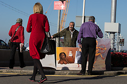 © Licensed to London News Pictures . 30/09/2015 . Brighton , UK . Artist KAYA MAR displays his work , including a painting of Jeremy Corbyn and Diane Abbot naked , outside the conference venue . The 2015 Labour Party Conference . Photo credit : Joel Goodman/LNP