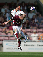Photo: Lee Earle. <br /> Northampton Town v Swindon Town. Coca Cola Championship. 11/08/2007. <br /> Swindon's Hasney Aljofree (B) put pressure on Andy Kirk.