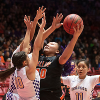 Gallup Bengal Hailey Long (40) is surrounded by Kirtland Central Broncos as she looks to the basket during their 4A girls NMAA State Basketball quarterfinal playoff game at Dreamstyle Arena (The Pit) Tuesday night in Albuquerque. The Broncos beat the Bengals 61-54 to advance to the semifinal round.