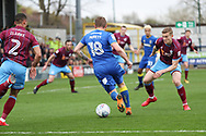 AFC Wimbledon midfielder Dean Parrett (18) dribbling into a crowded box during the EFL Sky Bet League 1 match between AFC Wimbledon and Scunthorpe United at the Cherry Red Records Stadium, Kingston, England on 7 April 2018. Picture by Matthew Redman.