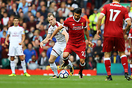 Emre Can of Liverpool (c) gets away from Ashley Barnes of Burnley. Premier League match, Liverpool v Burnley at the Anfield stadium in Liverpool, Merseyside on Saturday 16th September 2017.<br /> pic by Chris Stading, Andrew Orchard sports photography.