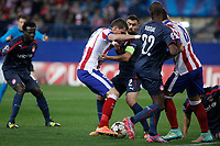 Atletico de Madrid´s Mandzukic (L) and Olympiacos´s Abidal and Maniatis during Champions League soccer match between Atletico de Madrid and Olympiacos at Vicente Calderon stadium in Madrid, Spain. November 26, 2014. (ALTERPHOTOS/Victor Blanco)