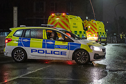 © Licensed to London News Pictures. 08/10/2020. London, UK. A Metropolitan Police vehicle parked across Ferry Lane in front of London Ambulance Service incident response vehicles. At approximately 21:15BST a male was seen to enter the water near Ferry Road in Tottenham following a police pursuit from the Hackney / Tower Hamlets area of a number of males riding mopeds. Emergency services attended and a large scale search was launched. Photo credit: Peter Manning/LNP