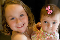 Two delightful children aglow during the Rodriguez-Gormley wedding.