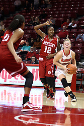 30 January 2015:  Taylor Stewart gets past Fantasia Vine and heads for the paint and Tamya Sims during an NCAA women's basketball game between the Bradley Braves and the Illinois Sate Redbirds at Redbird Arena in Normal IL