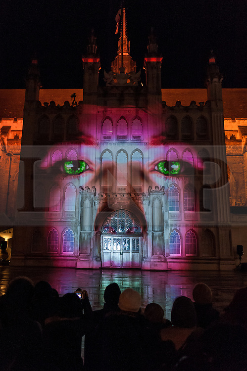 """© Licensed to London News Pictures. 05/03/2016. London, UK. Visitors gather to watch the """"Son et Lumière"""" at Guildhall.  The spectacular light and sound production celebrates the City's connection to Shakespeare, on the 400th anniversary of his death.  The historic façade of Guildhall is brought to life with 3D projection mapping technology accompanied by a special music composition by the Guildhall School of Music & Drama. Photo credit : Stephen Chung/LNP"""