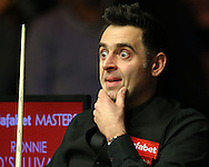 Ronnie O'Sullivan (Eng) has his eyes wide open as he looks on.  Ronnie O'Sullivan v Liang Wenbo, 1st round match at the Dafabet Masters Snooker 2017, day 1 at Alexandra Palace in London on Sunday 15th January 2017.<br /> pic by John Patrick Fletcher, Andrew Orchard sports photography.