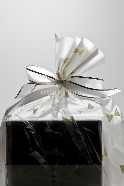 gift wrapped box knotted with a white bow