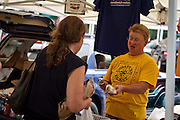 Anne Brau with Compass Plant speaks the praises of her fresh garlic at Thursday's Farmers' Market in Grinnell, Iowa.