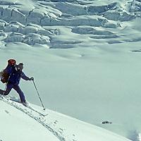Bearing a heavy pack, ski mountaineer Allan Pietrasanta telemarks in knee deep powder below 16,000 foot Warwan Pass during a pioneering two-week ski expedition from Ladakh to Kashmir, across India's Great Himalaya Range.