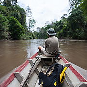 Hymeir Kem rides a boat out to Earth Lodge, Ulu Muda Forest Reserve, Kedah, Malaysia