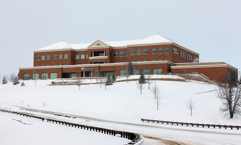 The new Martha Jefferson outpatient center on Pantops covered in snow during an early spring in Charlottesville, VA.