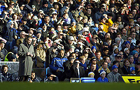 26/12/2004 - FA Barclays Premiership - Chelsea v Aston Villa - Stamford Bridge<br />Chelsea coach Jose Mourinho writes in his notebook on the touchline as the crowd shield their faces from the low winter sunlight<br />Photo:Jed Leicester/Back Page Images