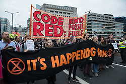 Extinction Rebellion climate activists cross London Bridge after blockading the City of London on the eleventh day of their Impossible Rebellion protests on 2nd September 2021 in London, United Kingdom. The activists included over fifty wearing signs indicating that they were breaking restrictive bail conditions by entering the City of London. Extinction Rebellion are calling on the UK government to cease all new fossil fuel investment with immediate effect.