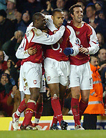 Photo: Daniel Hambury, Digitalsport<br /> Arsenal V Crystal Palace.<br /> FA Barclays Premiership.<br /> 14/02/2005.<br /> Arsenal's L-R Lauren, Thierry Henry and Edu celebrate the Frenchman's goal.