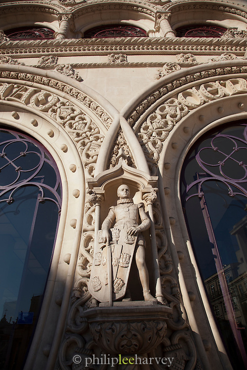 A statue of a knight stands outside the Restauradores metro station in Lisbon, Portugal
