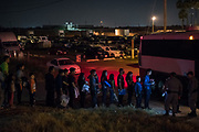 Central American migrant families who turned themselves to U.S. Border Patrol to seek asylum after crossing the Rio Grande are loaded onto a transport bus in Hidalgo, Texas, U.S., August 23, 2019.