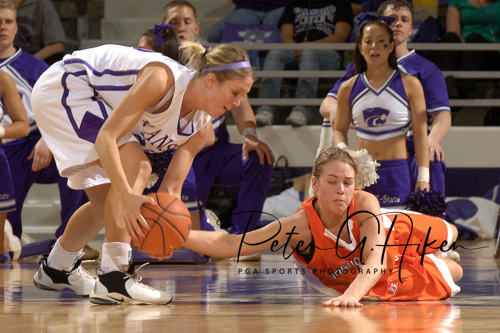 Idaho State guard Jeni Boesel (R) dives for a loose ball with Kansas State's Danielle Zanotti (L), during the first half at Bramlage Coliseum in Manhattan, Kansas, March 17, 2006.  K-State defeated the Bengals 88-68 in the first round of the WNIT.