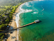 Aerial photograph of beautiful Hanalei Bay, Kauai, Hawaii, with the historic Hanalei Pier in the foreground