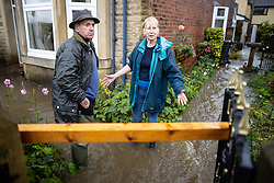 © Licensed to London News Pictures. 06/10/2020. Bury, UK. PETER and JEAN CRABTREE (both 76) in their flooded home . Houses and roads flood on Tottington Road in Bury after drainage systems are overwhelmed by the volume of water and blockages in the wake of persistent, heavy rain . Photo credit: Joel Goodman/LNP