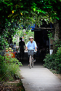 Elderly man on bicycle.  Mekong River in Cai Be, Tien Giang Province, Vietnam
