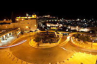 A nighttime view of the Old City of Jerusalem in Israel.
