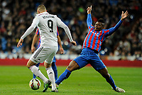 Real Madrid´s Karim Benzema and Levante UD´s Kalu Uche during 2014-15 La Liga match between Real Madrid and Levante UD at Santiago Bernabeu stadium in Madrid, Spain. March 15, 2015. (ALTERPHOTOS/Luis Fernandez)