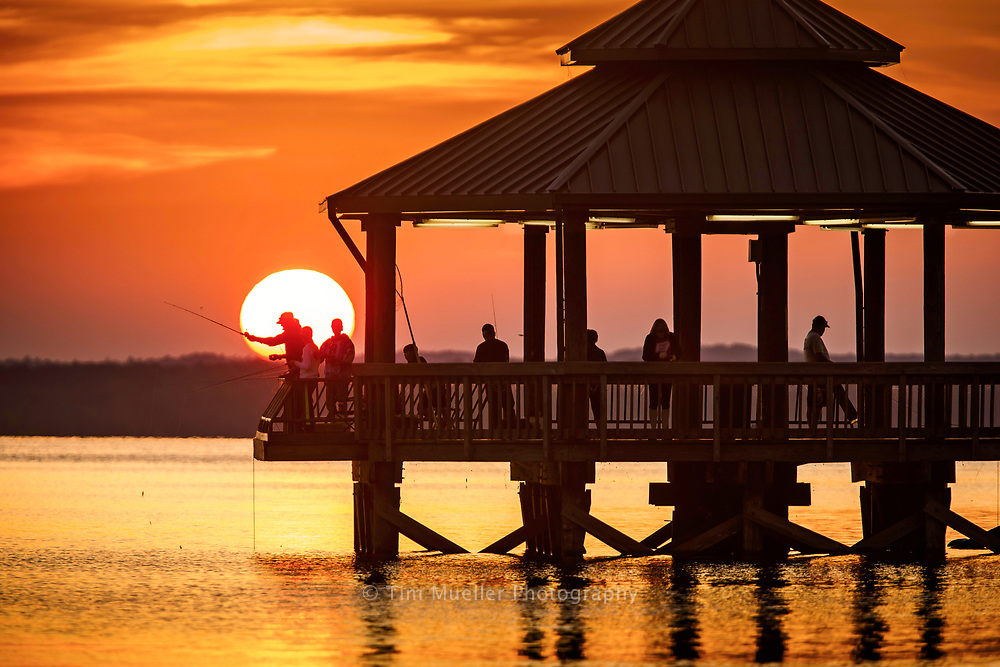As the sunsets over Toledo Bend Lake fishing enthusiast cast their lines from the fishing pier at Cypress Bend Park near Many, La. Bassmaster Magazine recently named Toledo Bend Lake the number one bass fishing lake in the United States.