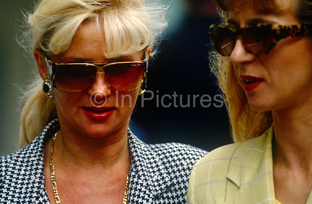 Two women seen in close-up while shopping in Knightsbridge.