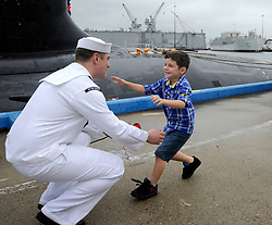 NEW LONDON, Conn. (Aug. 13, 2014) Sonar Technician (Submarine) 2nd Class Robert Culbertson hugs his five year old son moments after the Virginia-class attack submarine USS New Hampshire (SSN 778) returns to homeport at Submarine Base New London in Groton, Conn., following a six-month deployment.  New Hampshire conducted operations in the U.S. European Command area of responsibility. (U.S. Navy photo by John Narewski/Released) 140813-N-UM744-001<br /> Join the conversation<br /> http://www.navy.mil/viewGallery.asp<br /> http://www.facebook.com/USNavy<br /> http://www.twitter.com/USNavy<br /> http://navylive.dodlive.mil<br /> http://pinterest.com<br /> https://plus.google.com
