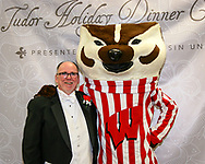 Bucky Badger joined the Philharmonic Chorus of Madison for a rare matinee performance Sunday, December 13, 2015. in Union South, and is pictured here with Chorus Director Patrick Gorman.