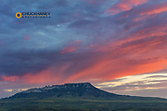 Vivid sunrise clouds above Square Butte in the Highwood Mountains near Coffee Creek, Montana, USA
