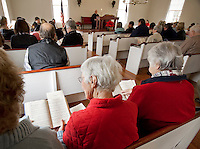 Reverend Sidney Lovett welcomes all to join in the singing O Little Town of Bethlehem during the First Congregational Society's Christmas Service at the Smith Meetinghouse in Gilmanton on Sunday afternoon.  (Karen Bobotas/for the Laconia Daily Sun)