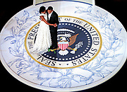 First lady Michelle Obama and President Barack Obama dance on a replica of the presidential seal at the Commander-in-Chief Inaugural ball in Washington January 20, 2009. Obama took power as the first black U.S. president on Tuesday and quickly turned the page on the Bush years, urging Americans to rally to end the worst economic crisis in generations and repair the U.S. image abroad.     REUTERS/Jim Young (UNITED STATES)