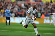 Andre Ayew of Swansea city celebrates after he scores his teams 1st goal. Barclays premier league match, Swansea city v Tottenham Hotspur at the Liberty Stadium in Swansea, South Wales on Sunday 4th October 2015.<br /> pic by  Andrew Orchard, Andrew Orchard sports photography.