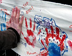 Children put handprints on a rainbow panel to show their support for children affected by HIV around the world in London's Trafalgar Square to mark World Aids Day. Between 500 and 800 campaigners, wearing T-shirts emblazoned with the slogan HIV Positive, were expected to assemble in the square this morning to mark World Aids Day. See PA Story HEALTH Aids Events. PRESS ASSOCIATION PHOTO. Photo credit must read: Michael Stephens.