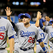 NEW YORK, NEW YORK - May 29:  Chase Utley #26 (center), of the Los Angeles Dodgers celebrates a win with team mates during the Los Angeles Dodgers Vs New York Mets regular season MLB game at Citi Field on May 29, 2016 in New York City. (Photo by Tim Clayton/Corbis via Getty Images)